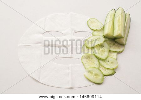 natural sheet mask extracts from cucumber for the face skin care brightening on background white