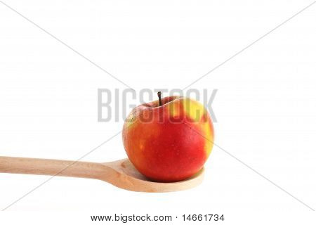 Tangelo On A Wooden Spoon