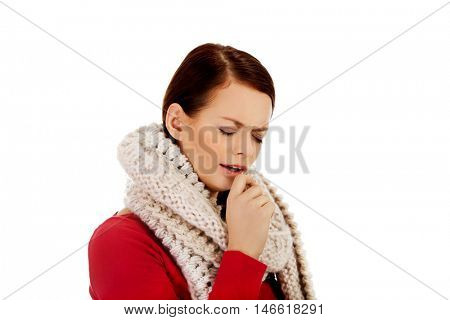 Young woman has a flu. Coughing