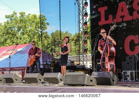 St. Petersburg, Russia - 12 August, The trio of musicians on stage,12 August, 2016. Pop and rock musicians on Harley Davidson festival in St. Petersburg.