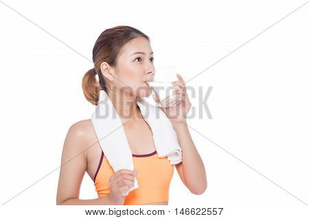 Portrait of fitness young asian woman with towel drinking water on white background