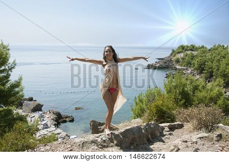 young beautiful sexy woman on the sea background