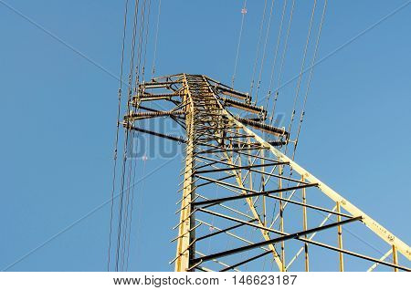 one electricity pylons , and power plant in Spain