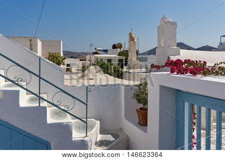Small white church with flowers in town of Parakia, Paros island, Cyclades, Greece