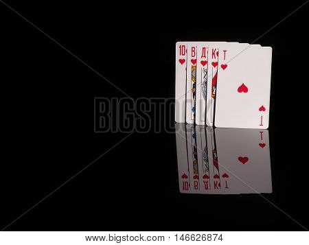 Royal flush playing cards isolated on black background. casino concept
