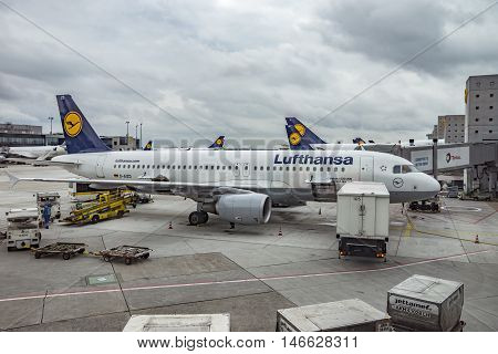 FRANKFURT AM MAIN GERMANY - JUNE 30 2016: Aircrafts at the gate in Terminal 1 in Frankfurt Germany. Terminal 1 was completed in 1972 and houses Lufthansa and other Star Alliance partners.