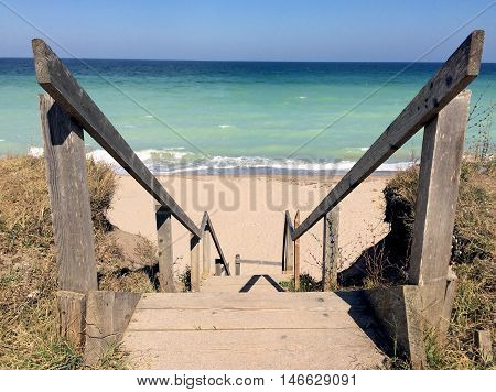 Wooden stairs leading to sandy secluded beach