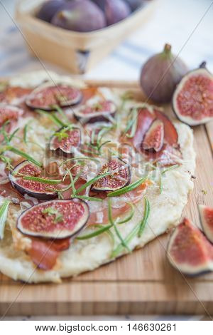 freshly baked French Flammkuchen with figs and cheese