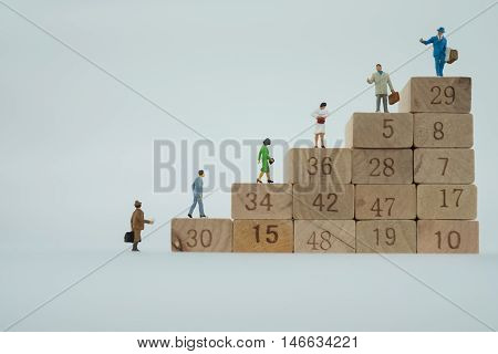 Business Man Figures On The Career Stairs, Business Concept, Career Path