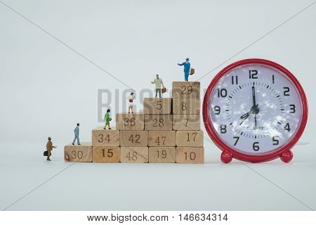 Business Man Figures On The Career Stairs, Business Concept, Career Path, And Time