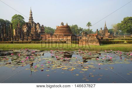 The ruins of the ancient Buddhist temple Wat Mahathat in the morning sun. Sukhothai, Thailand