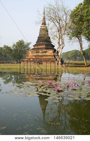 The ancient Chedi on the lake. Sukhothai, Thailand