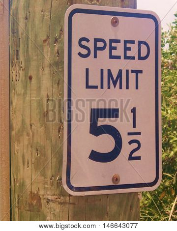Speed limit sign along a road in Belize