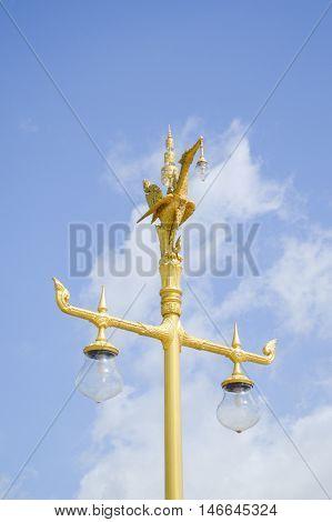 close up golden swan lamp post in garden