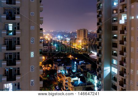 Night view of modern skyscrapers with apartments in Noida, Delhi India. Development has given rise to many such projects to house the growing population