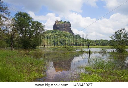 View on the Sigiriya from the ancient artificial lake. Sri Lanka