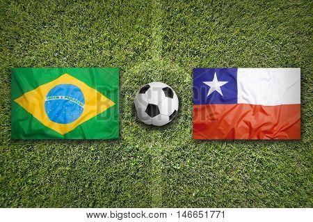 Brazil vs. Chile flags on green soccer field 3D illustration