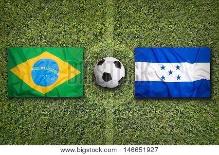 Brazil Vs. Honduras Flags On Soccer Field, 3D Illustration
