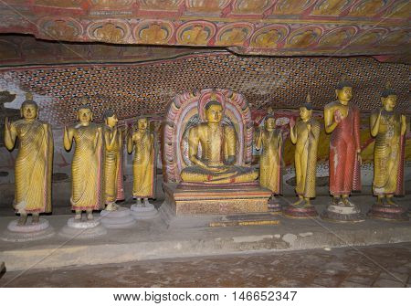 DAMBULLA, SRI LANKA - MARCH 14, 2015: Ancient Buddha statues in the cave Buddhist temple. Religious landmark  of the city Dambulla, Sri Lanka