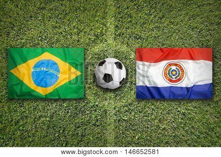 Brazil Vs. Paraguay Flags On Soccer Field, 3D Illustration