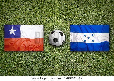 Chile Vs. Honduras Flags On Soccer Field, 3D Illustration