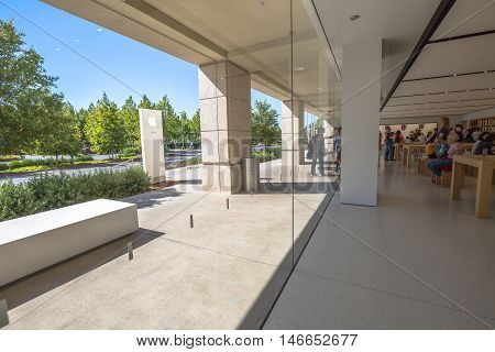 Cupertino, CA, USA - August 15, 2016: people inside the Apple store of Apple Inc HQ at One Infinite Loop. Apple is a multinational corporation that produces consumer electronics, computers, software.