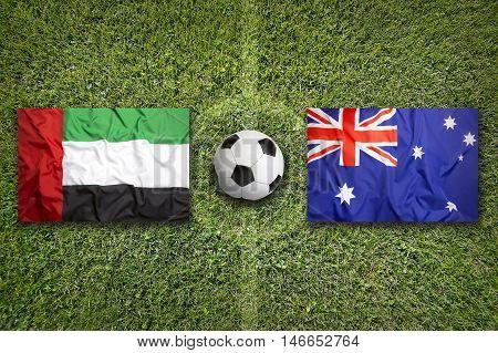 United Arab Emirates Vs. Australia Flags On Soccer Field, 3D Illustration