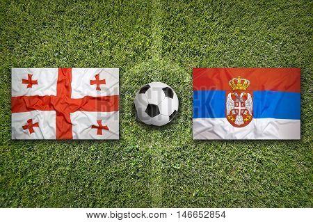 Georgia Vs. Serbia Flags On Soccer Field, 3D Illustration