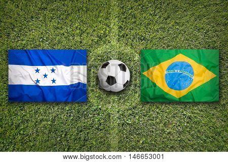 Honduras Vs. Brazil Flags On Soccer Field, 3D Illustration