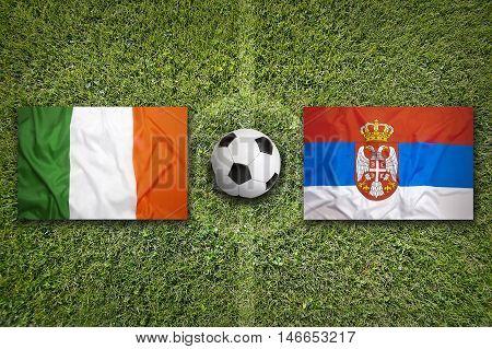 Ireland Vs. Serbia Flags On Soccer Field, 3D Illustration