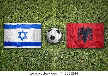 Israel Vs. Albania Flags On Soccer Field, 3D Illustration