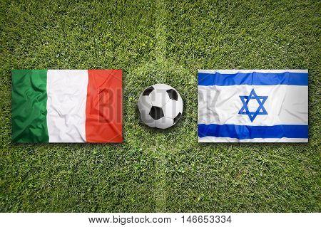 Italy Vs. Israel Flags On Soccer Field, 3D Illustration