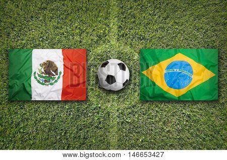 Mexico vs. Brazil flags on green soccer field 3D illustration