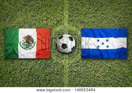 Mexico Vs. Honduras Flags On Soccer Field, 3D Illustration