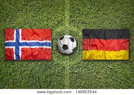 Norway Vs. Germany Flags On Soccer Field, 3D Illustration