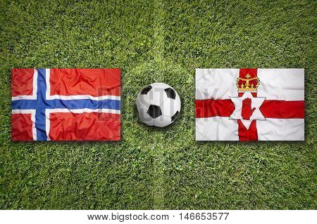 Norway Vs. Northern Ireland Flags On Soccer Field, 3D Illustration