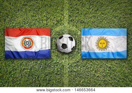 Paraguay Vs. Argentina Flags On Soccer Field, 3D Illustration