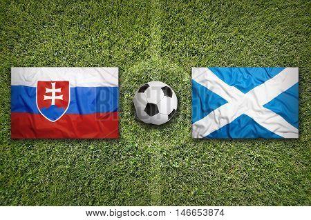 Slovakia Vs. Scotland Flags On Soccer Field, 3D Illustration