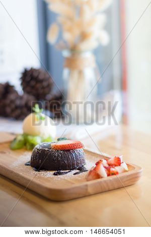 chocolate lava cake with vanilla ice cream and strawberry. Chocolate lava. Hot chocolate pudding with fondant centre.(selective focus)