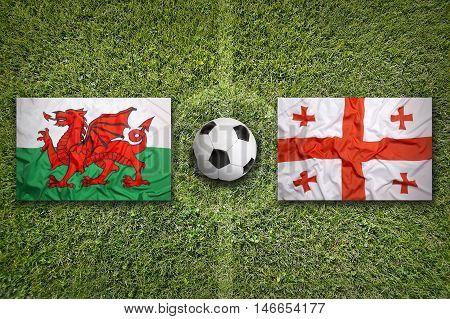Wales Vs. Georgia Flags On Soccer Field, 3D Illustration
