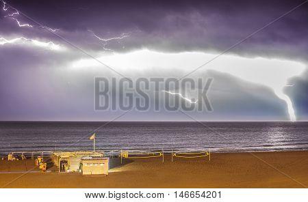 Lightening storm over sea close to beach bar