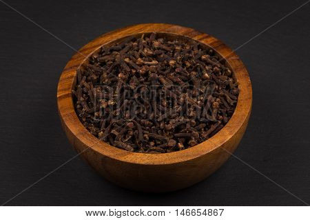 Clove Spice In Wooden Bowl