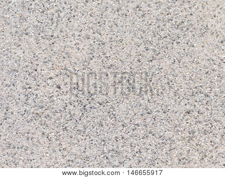 rough matte gray surface of fine granite gravel bighead