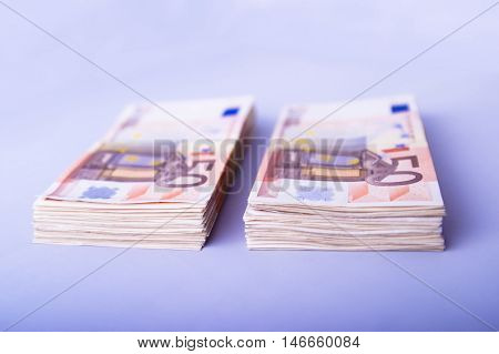 Two Piles Of Fifty Euros