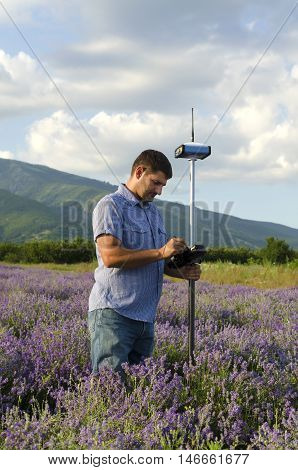 Land surveyor working in the lavender field