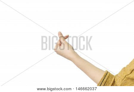 Closeup action of woman hand in mini heart by forefinger and thumb isolated on white background with clipping path