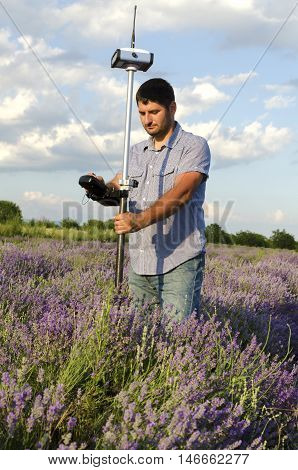 Land surveying in a lavender field during the day