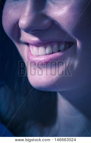 Closeup of broad smile woman smiling happy