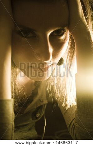 Moody image of a sensual looking woman in warm light