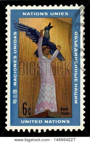 United Nations, Geneva - CIRCA 1969: a stamp printed in Geneva shows the happy future of mankind, sculpture by Henrik Starcke, circa 1969